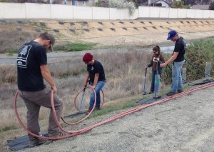Watering over a thousand holes efficiently requires hundreds of feet of hose and a 500 gallon water tank!