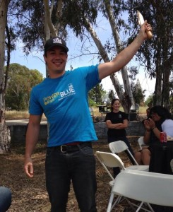 Mike Chu triumphantly waves his Outstanding Volunteer Golden Trowel Award.