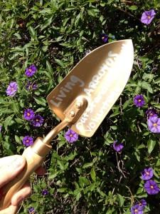 The Golden Trowel award gleams in the sun.